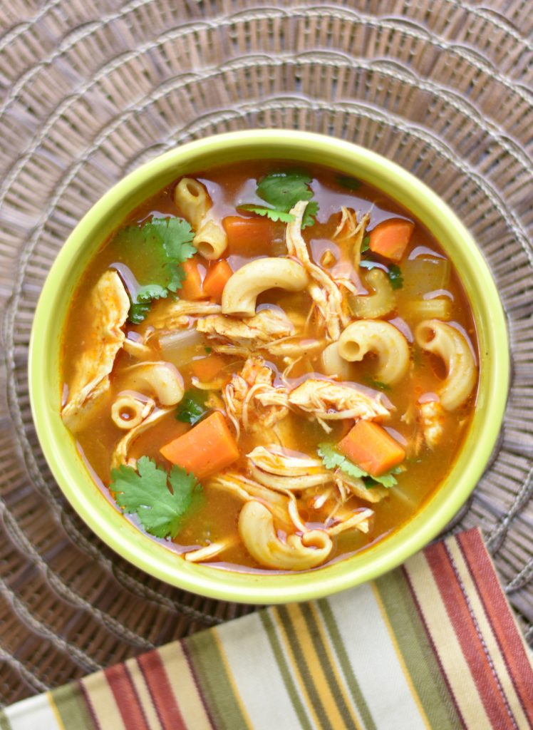 Instant pot Chicken Noodle Soup with Ethiopian spices by Spice Cravings. This classic Chicken Noodle soup is made by simmering chicken and vegetables, such as carrots and celery, spices, herbs and small noodles in chicken broth.  This recipe uses the Ethiopian Spice blend called Berbere Seasoning to enhance the flavor and made in an instant pot. #food #foodie #foodblogger #delicious #recipe #instantpot #recipes #easyrecipe #cuisine #30minutemeal #instagood #foodphotography #tasty