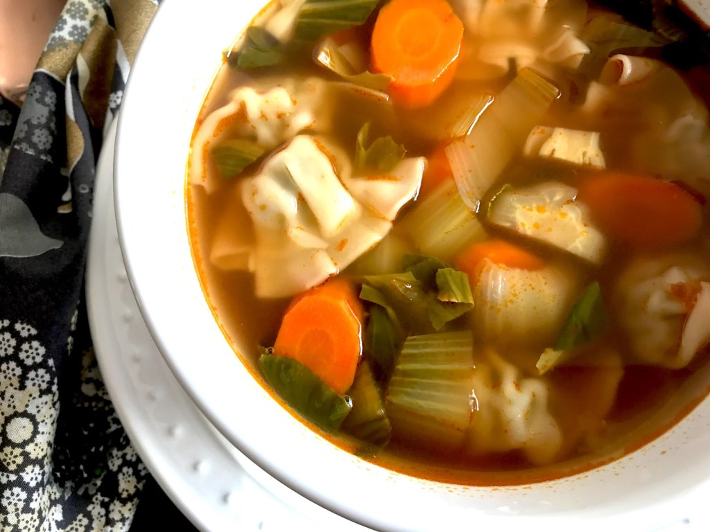 Instant Pot Chicken Wonton Soup recipe by Spice Cravings. Made with frozen wontons, cooked with a variety of vegetables, in a chicken broth in the instant pot. #cooking #food #recipe #recipes #foodphotography #foodblogger #yummy #delicious #foodie