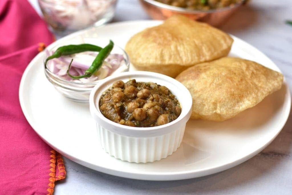 Chole Bhature, Punjabi Chole or Chana Masala Instant Pot by Spice Cravings. Punjabi Chole is a vegetarian north-Indian dish. This creamy, spicy and slight tangy dish is made withchickpeas, also calledGarbanzo beans or Chana (in Hindi) cooked with fresh onions, ginger, garlic and seasoned with a unique spice blend. #cooking #food #recipe #recipes #foodphotography #foodblogger #yummy #delicious #foodie