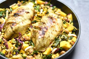 Jamaican Jerk Chicken Recipe made by marinating the chicken in a rich cocktail of bold and earthy spices. This recipe can be made in an instant pot, skillet or oven. Goes terrific with a sweet side like a Kale & Mango Slaw with Chickpeas. By Spice Cravings. #cooking #food #recipe #recipes #foodphotography #foodblogger #yummy #delicious #foodie