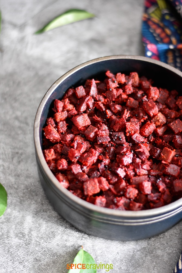 beet and coconut stir fry in black bowl
