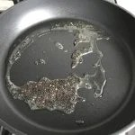 coconut oil and black mustard seeds in nonstick skillet
