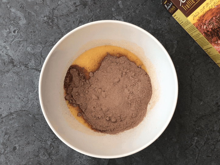 Adding brownie mix to the butter and eggs mixture