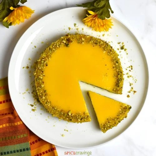 Sliced Indian cheesecake with Mango flavor, bakes in an Instant Pot