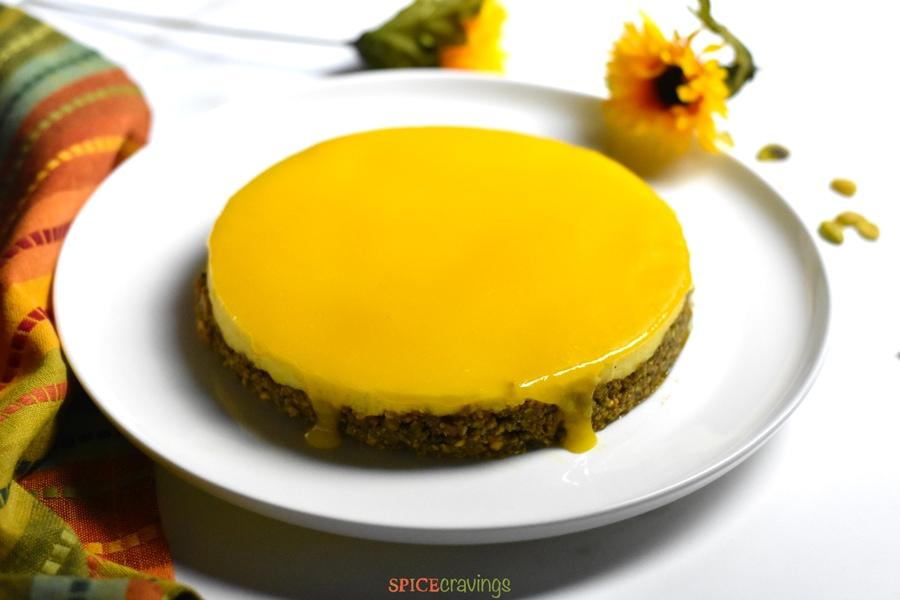 Top shot of mango topping on mango cheesecake