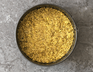 Pistachio crust set in a springform pan for Mango cheesecake