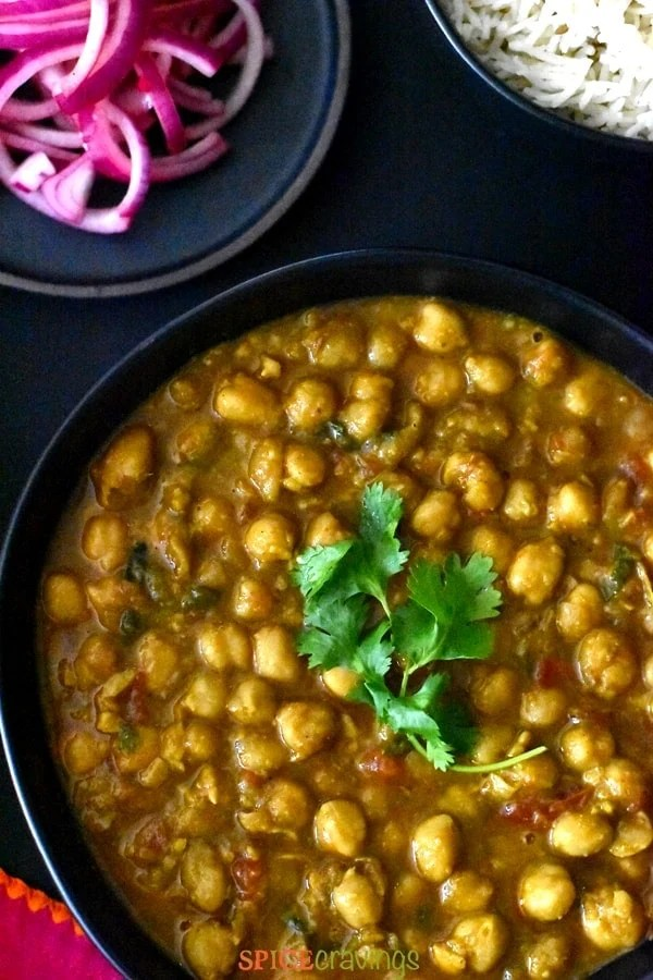 Chana masala in a black bowl