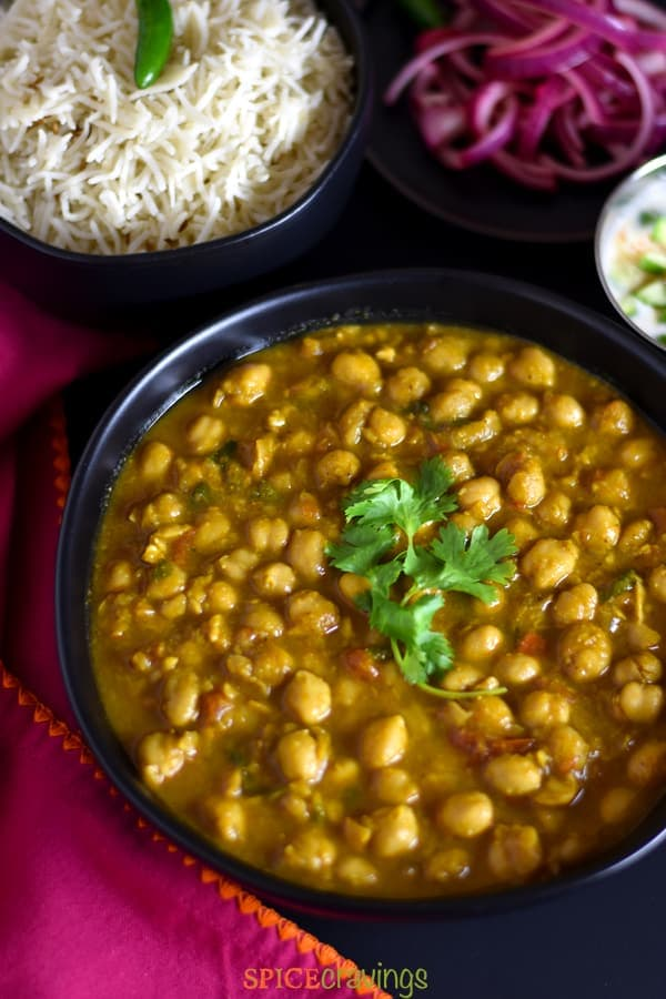 Indian spiced chana masala served in a black bowl