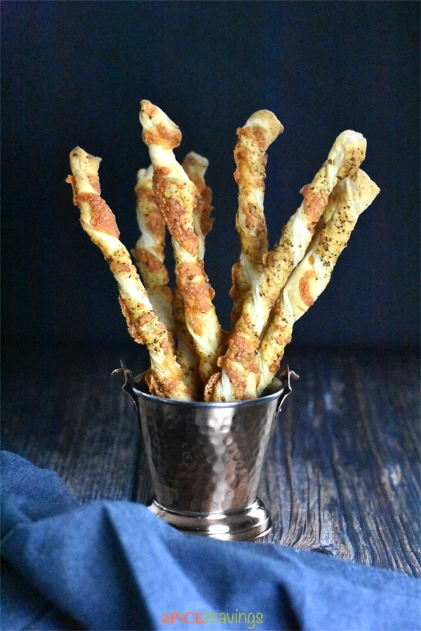 Cheese straws seasoned with Italian seasoning and cayenne