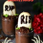 Two shot glasses that look like chocolate graveyards with tombstones