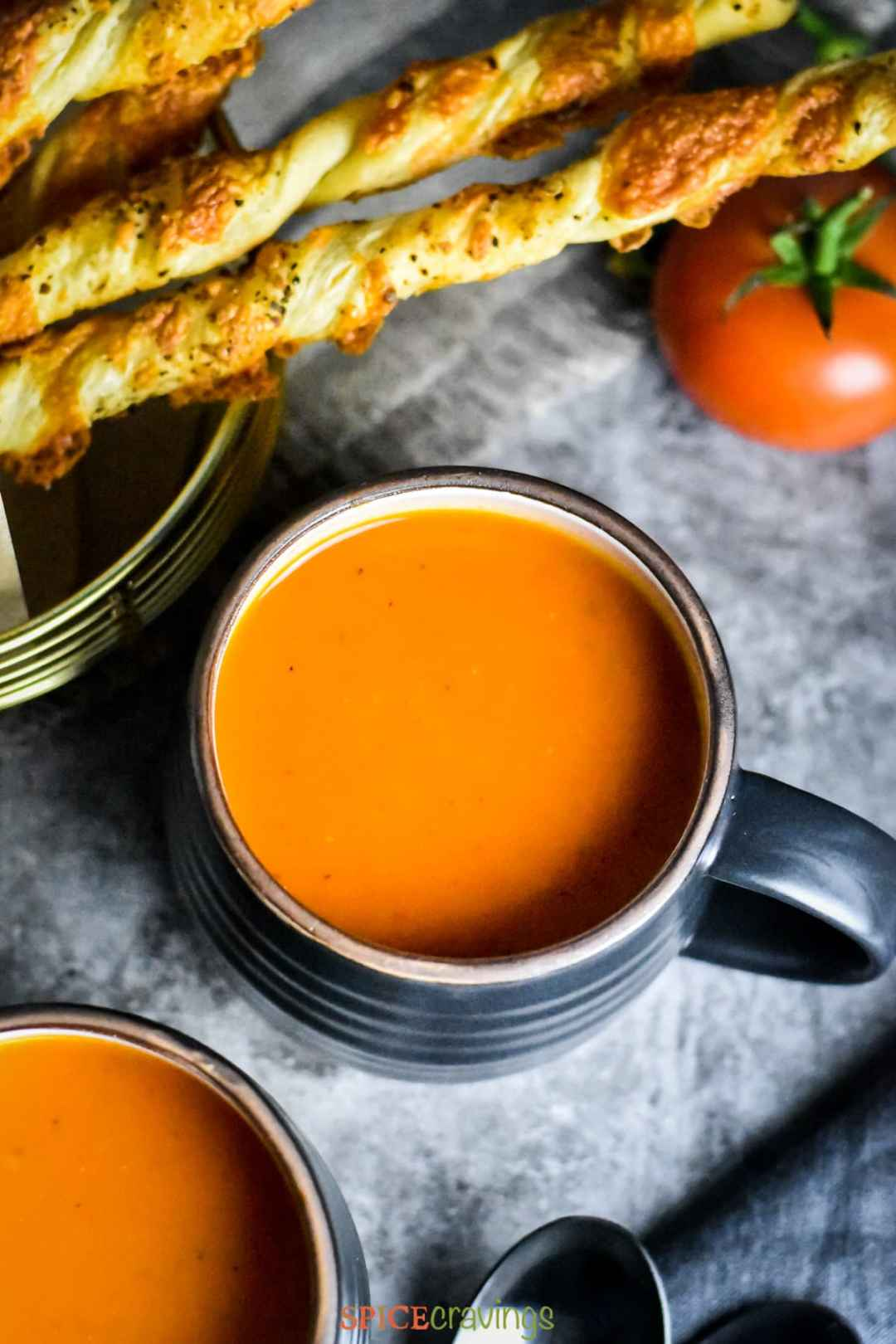 Roasted Red Pepper Tomato Soup in a black mug