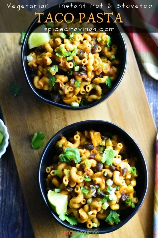 Two Bowls of cheesy taco pasta with black beans and corn