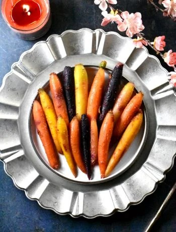 Honey glazed carrots served on a decorative silver platter
