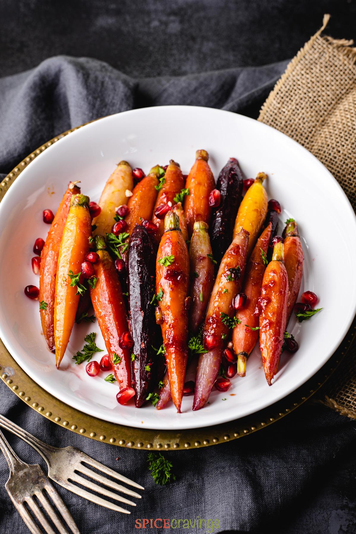 Honey glazed carrots served on a decorative silver platter