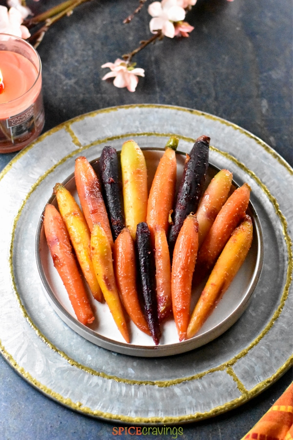 Easy thanksgiving or holiday side- honey glazed carrots served on a silver charger