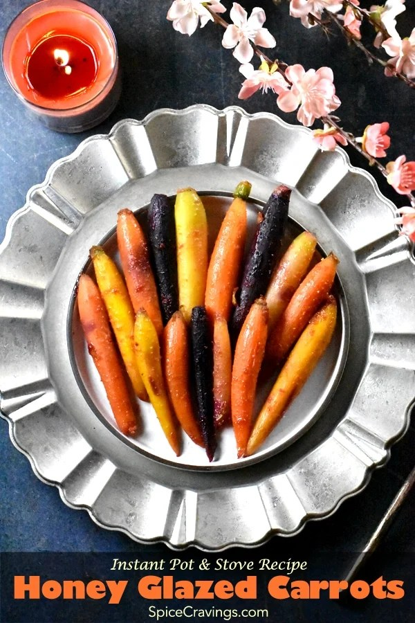 Citrus honey glazed carrots placed on a silver charger plate