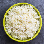 A green bowl of white fluffy basmati rice