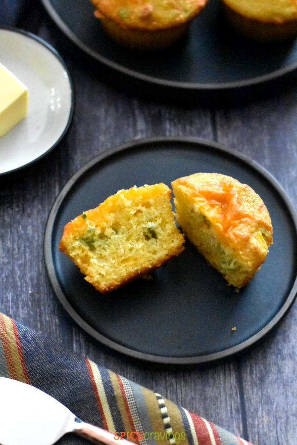 A plate of sliced Jalapeno Cheddar Cornbread Muffin