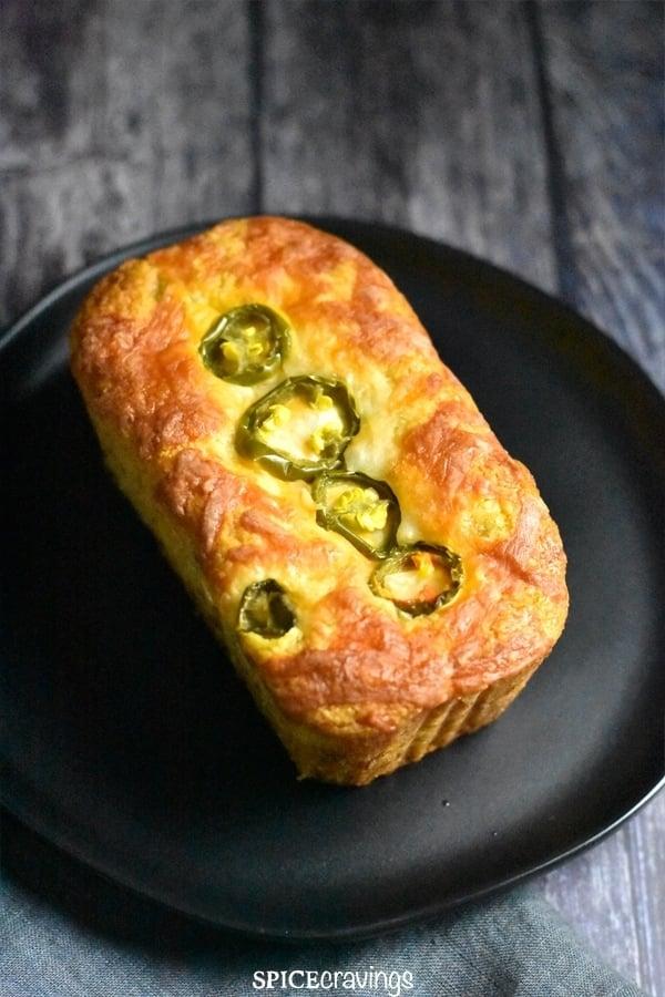 A golden brown loaf of Jalapeno cheddar cornbread