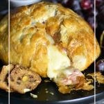 A delicious appetizer recipe with creamy baked brie melted inside a golden brown puff pastry dome