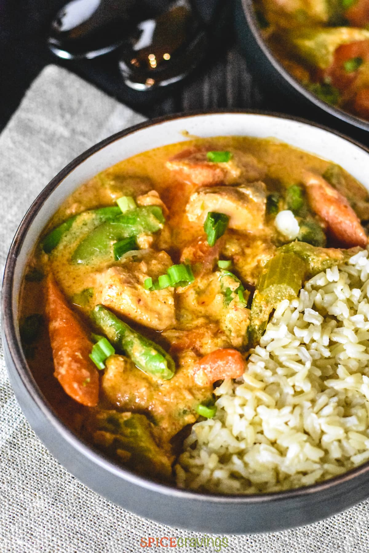 Tender Salmon cooked in coconut milk and red curry paste with crunchy vegetables like celery, carrots and snap peas, and served with brown jasmine rice