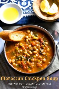 A bowl of chickpea soup served with toasted bread