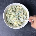 Mixing all ingredients for making Spinach Artichoke Dip