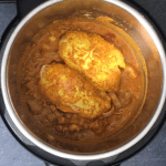 Cooking chicken on top of the sauce in the Instant pot