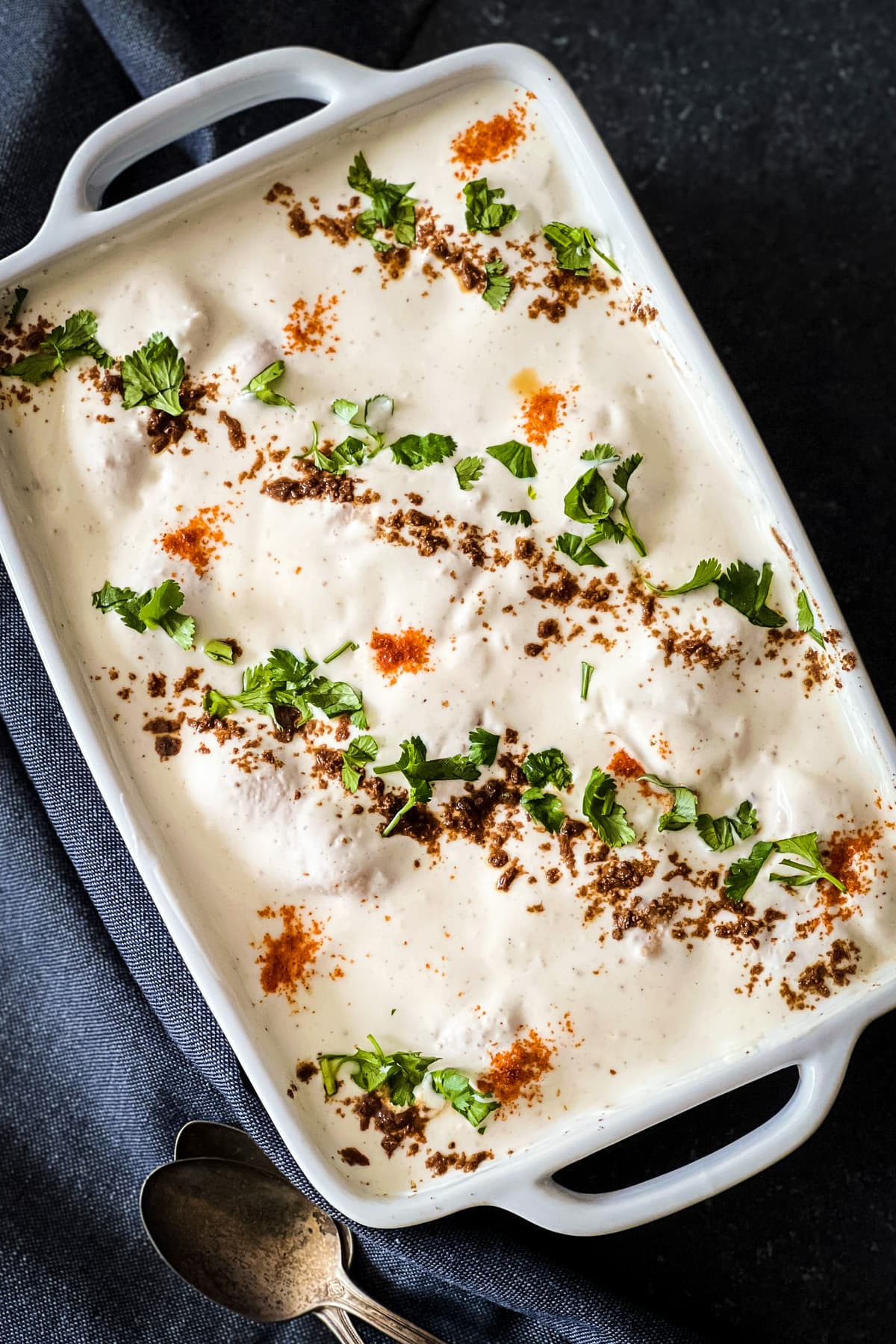No fry lentil fritters called Dahi Bhalle soaked in a spicy tangy yogurt.