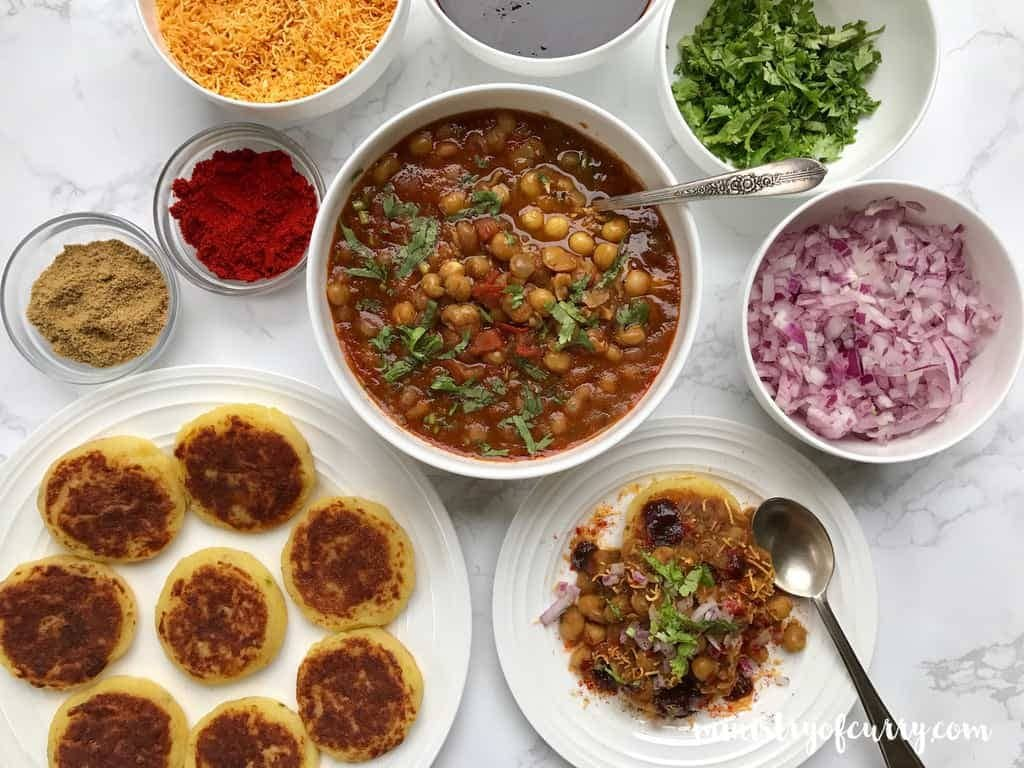 Mumbai style Ragda Pattice (white peas) served with an assortment of toppings and garnishes
