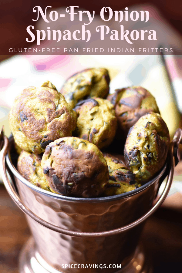 No Fry Onion Spinach Pakora, or Indian fritters, served in a rustic copper bowl