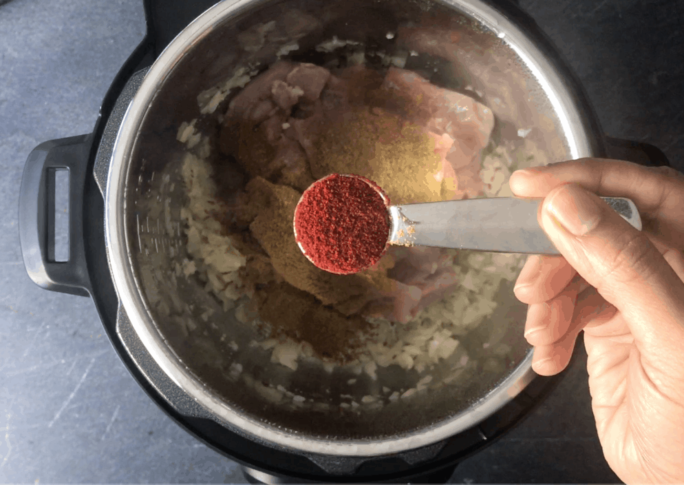 Adding spices to the pot