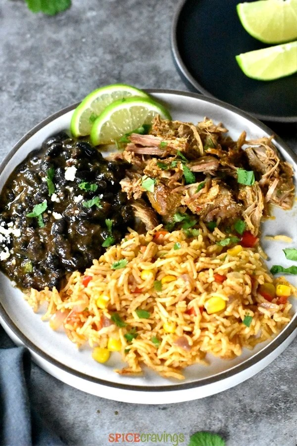 Pork carnitas served with mexican rice and beans
