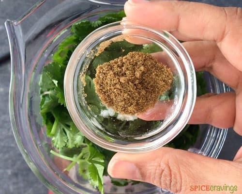 Adding cumin to make salsa