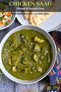 Indian chicken spinach curry called Saag Chicken served in a gray bowl