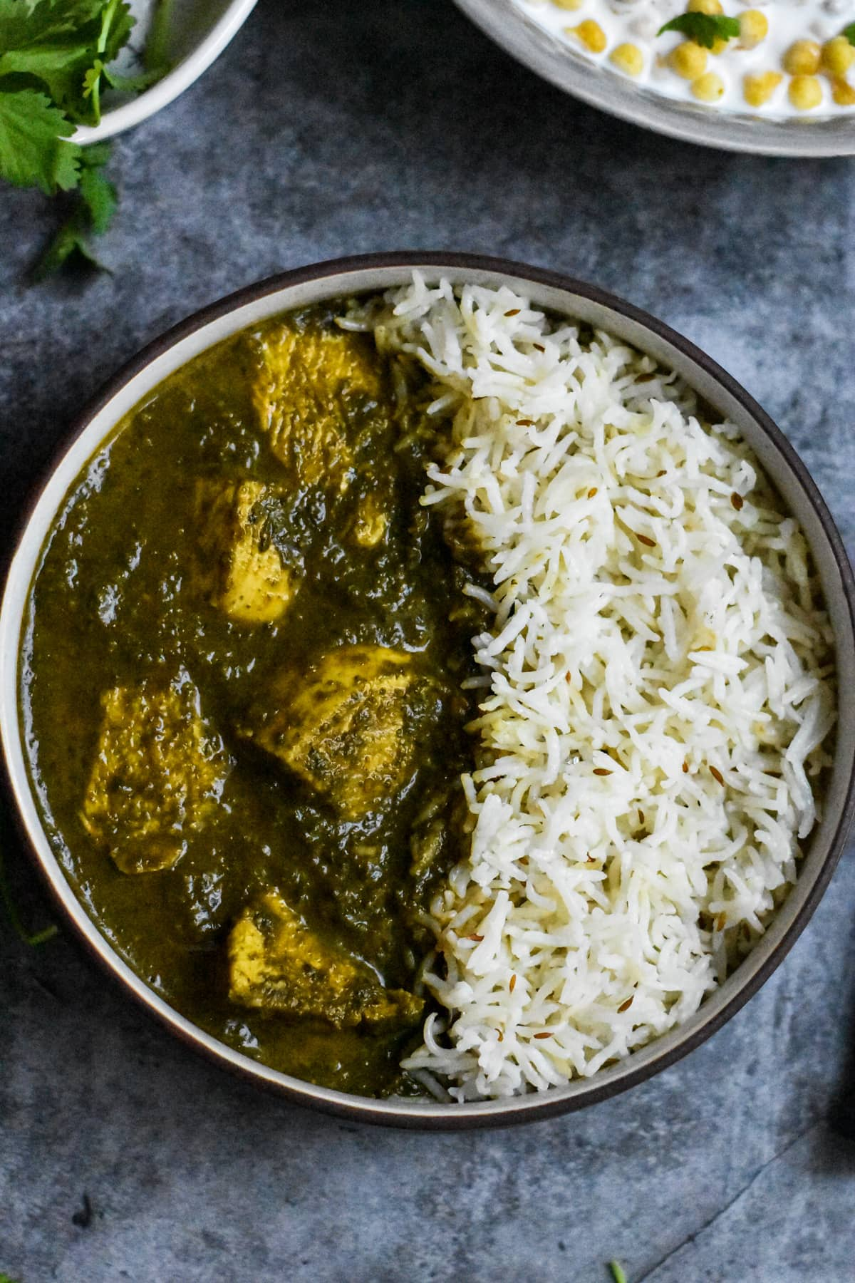 Chicken and spinach curry, Chicken Saag, served in a grey bowl