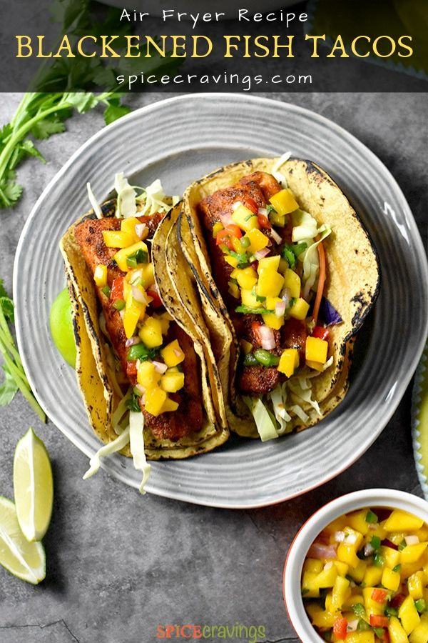 Two Fish Tacos garnished with mango salsa