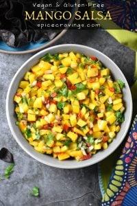 Fresh mango salsa garnished with lime and cilantro