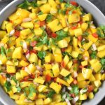 Mango salsa with peppers, onion and cilantro