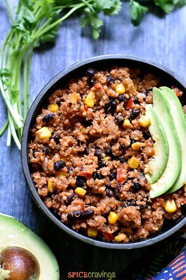 Quinoa burrito bowl with sliced avocado