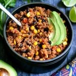 Mexican Quinoa garnished with sliced avocado