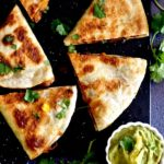 Black Bean quesadillas cut in triangles, served with guacamole