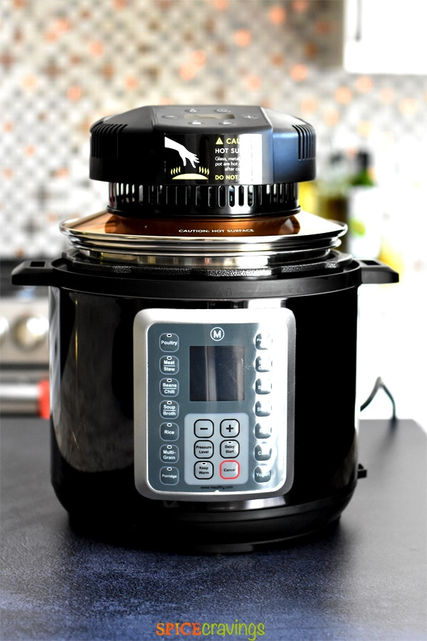 Mealthy Crisplid placed on top of Mealthy Multipot for cooking