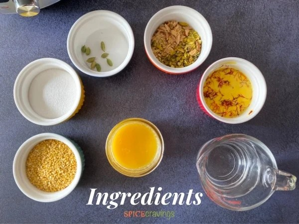Ingredients needed to make Moong Dal Halwa displayed on a grey counter.