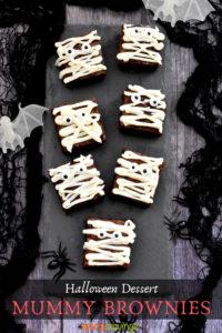 Chocolate brownies iced to look like 'mummies'