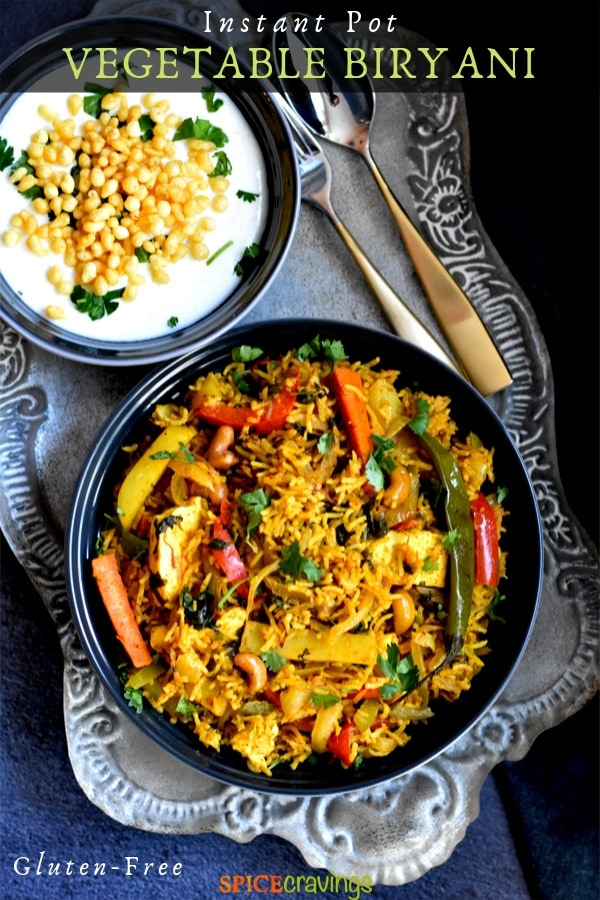 A bowl of Indian vegetable biryani served with yogurt