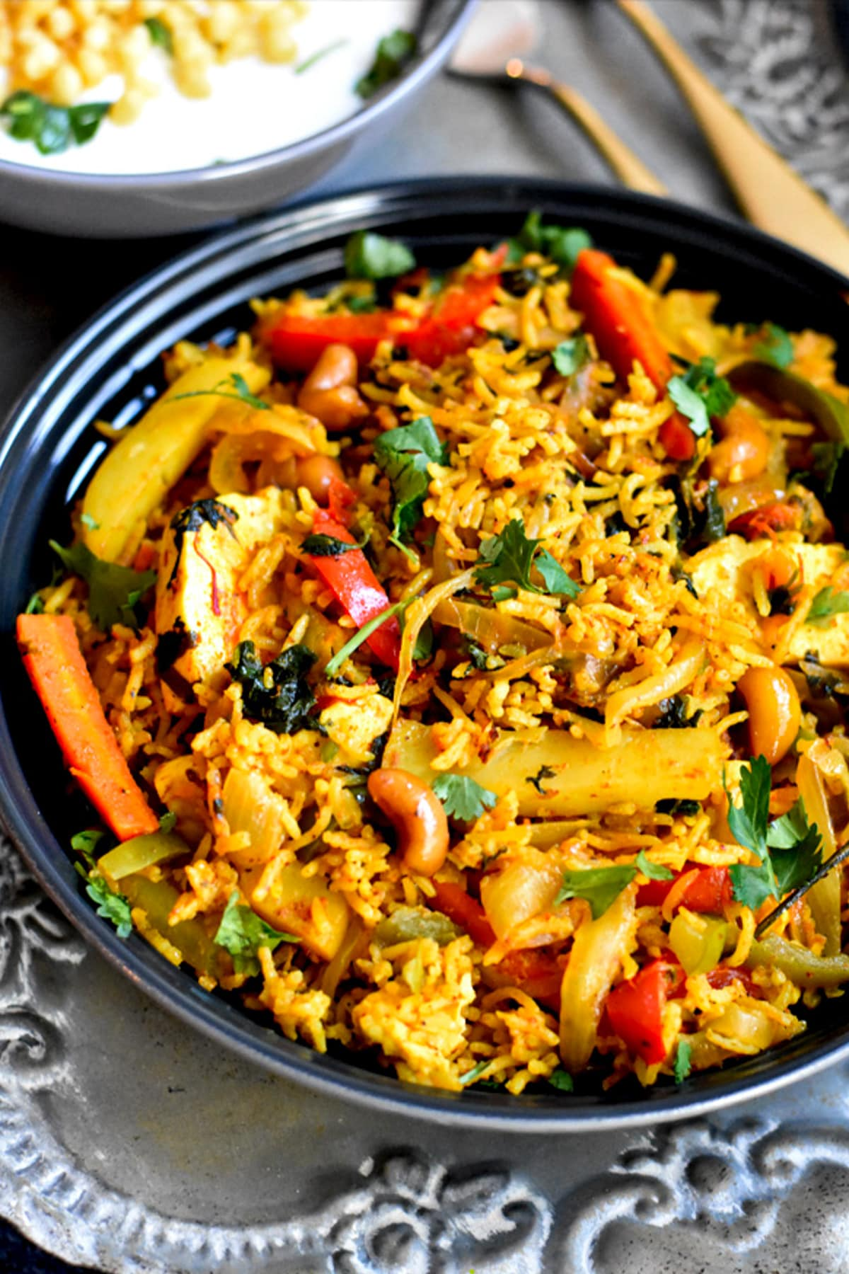 Rice cooked with vegetables and served with yogurt