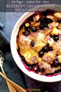 A partial view of a bread pudding bowl with blueberries