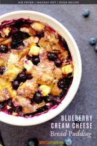 A close up of a bread pudding bowl with cream cheese and blueberries