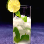 low carb mojito in highball glass garnished with lime slice with text overlay